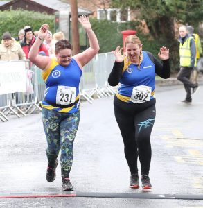 Two runners finishing happy